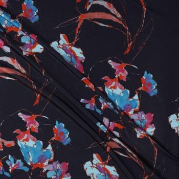 Estampado flor arlequin multicolor fondo negro